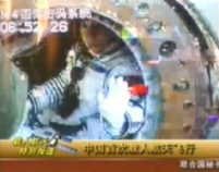 Lt. Col. Yang Liwei, China's first taikonaut, waves from his capsule after a safe return to the grasslands of Inner Mongolia on Thursday. (CCTV/APTN via AP)